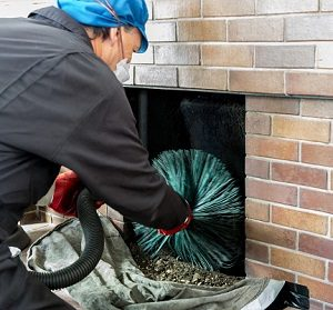 Sweeping cleaning a chimney.