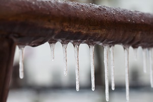 Frozen pipe covered in ice.