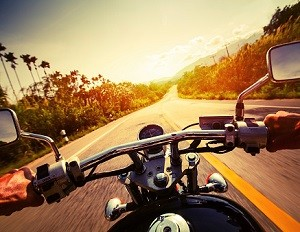 Taking a motorcycle out for a ride.