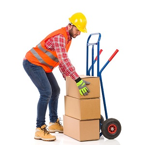 Man places package on hand truck.
