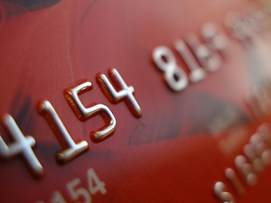 A close up of a red credit card