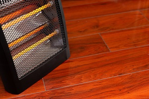 Space heater on a wooden floor