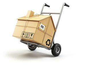 Hand truck with cardboard box as home isolated on white. Moving house concept.