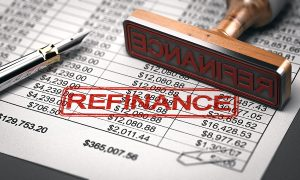 "A rubber stamp of ""Refinance"" on home pricing documentations"