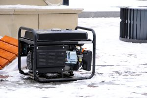 A portable electric generation being used to power a home in the snow during winter.