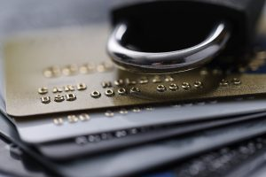 A stack of credit cards with a lock on top, signifying how to freeze your credit