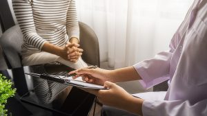 A psychiatrist giving consultation to a patient, meant to depict the need for professional liability insurance
